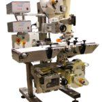 Sistema automatico per l'applicazione di una etichetta superiore prestampata ed una inferiore con stampa dati variabili su vaschette di verdura fresca