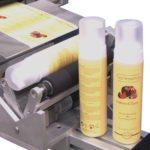 Etichettatrice semi-automatica per flaconi, bombolette aerosol con applicazione fronte & retro