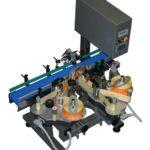 Sistema di etichettatura per applicazione fronte e retro su contenitori cilindrici