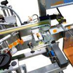 Sistema di applicazione sigilli di garanzia su astucci farmaceutici